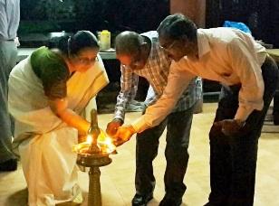 Lighting the lamp by the President Smt. Lakshmi Bai