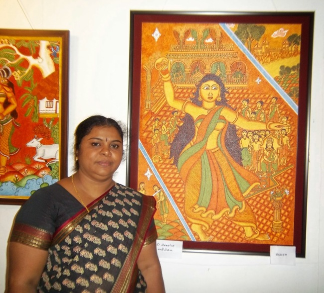 The artist with her paintings in the back-drop
